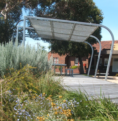 Shadows shade metal art in the garden structures in hot for Metal sun shade structures