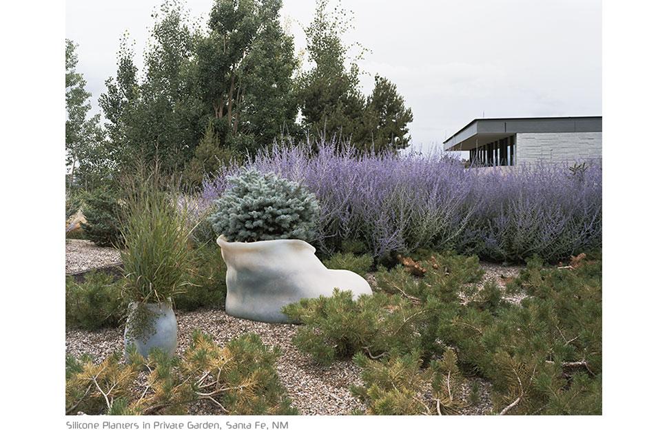 planter pots by paula hayes in a landscape