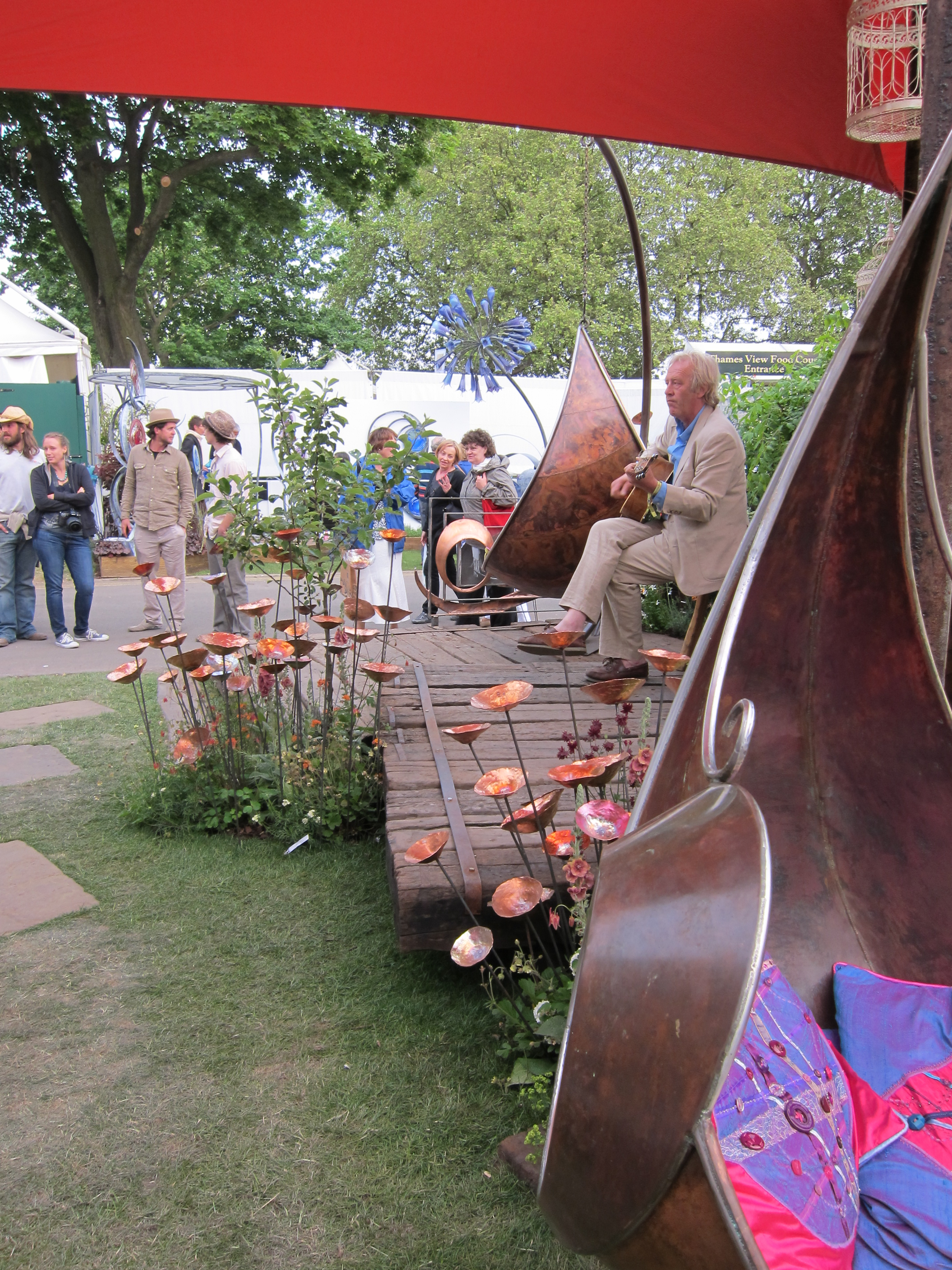 copper garden accessories and hanging chairs