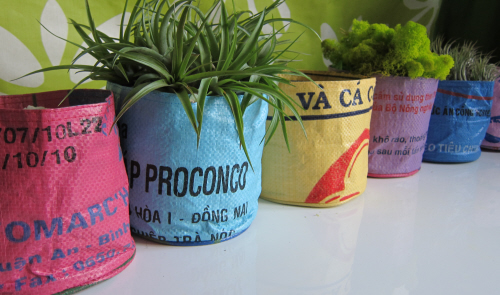 A row of recycled rice bag planters